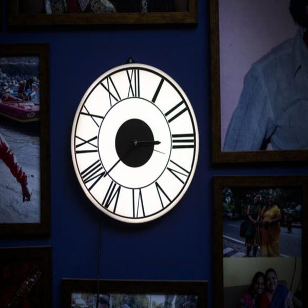 A Back Lit Wall Clock First Birthday Gifts for Husband After Marriage